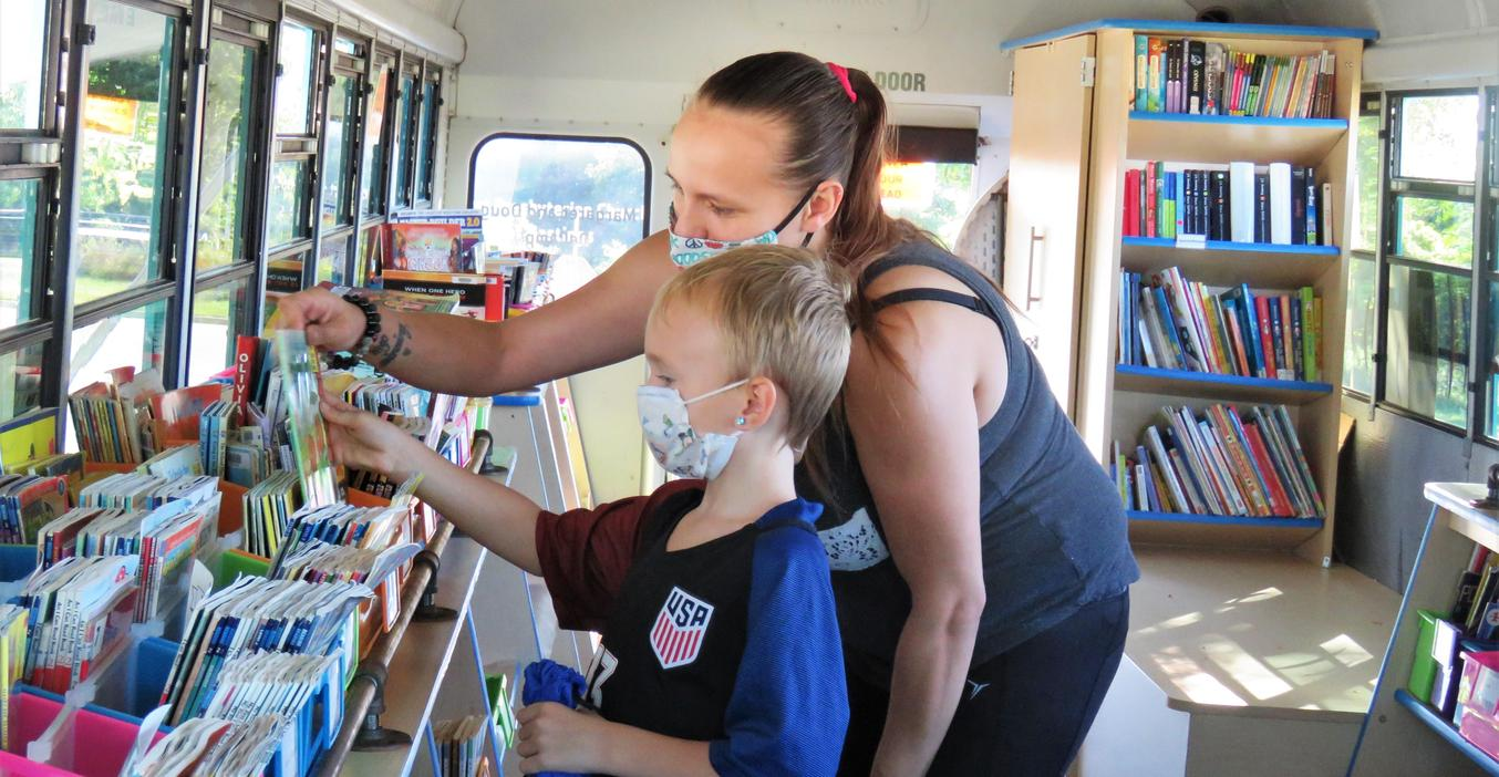 TK Virtual School students pick out books from the mobile B. Bus.
