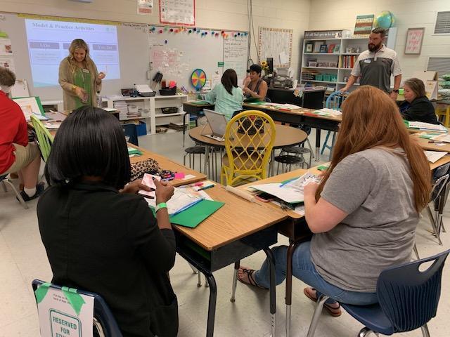 Parents meeting with teacher for APTT
