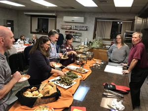 OLSH parents enjoy dinner together at an evening parent social event