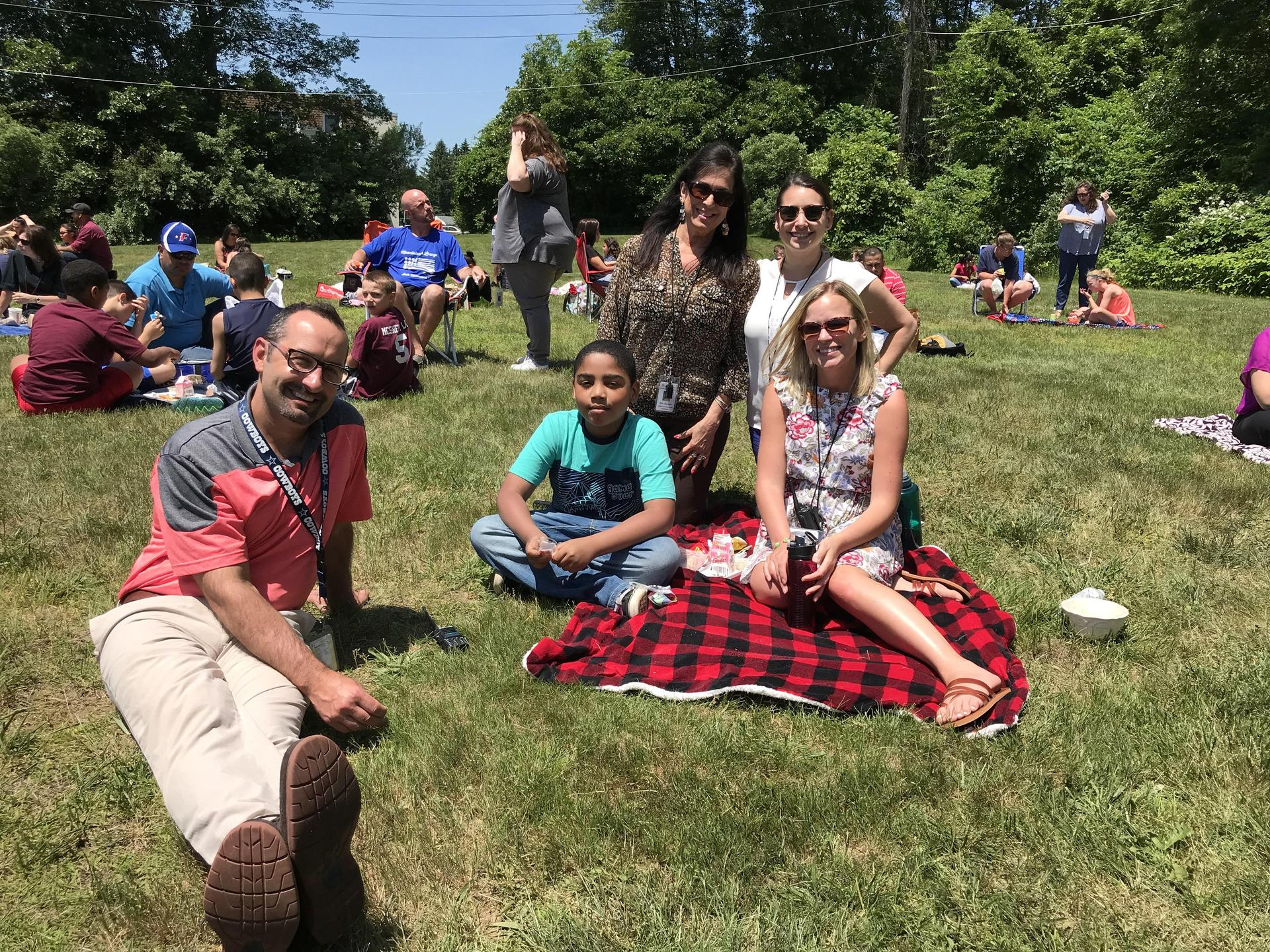 Teachers picnic with students.