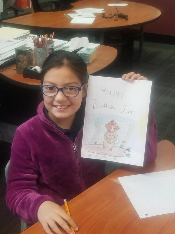 Angele Rubio and her birthday card for Dr. Jane Goodall