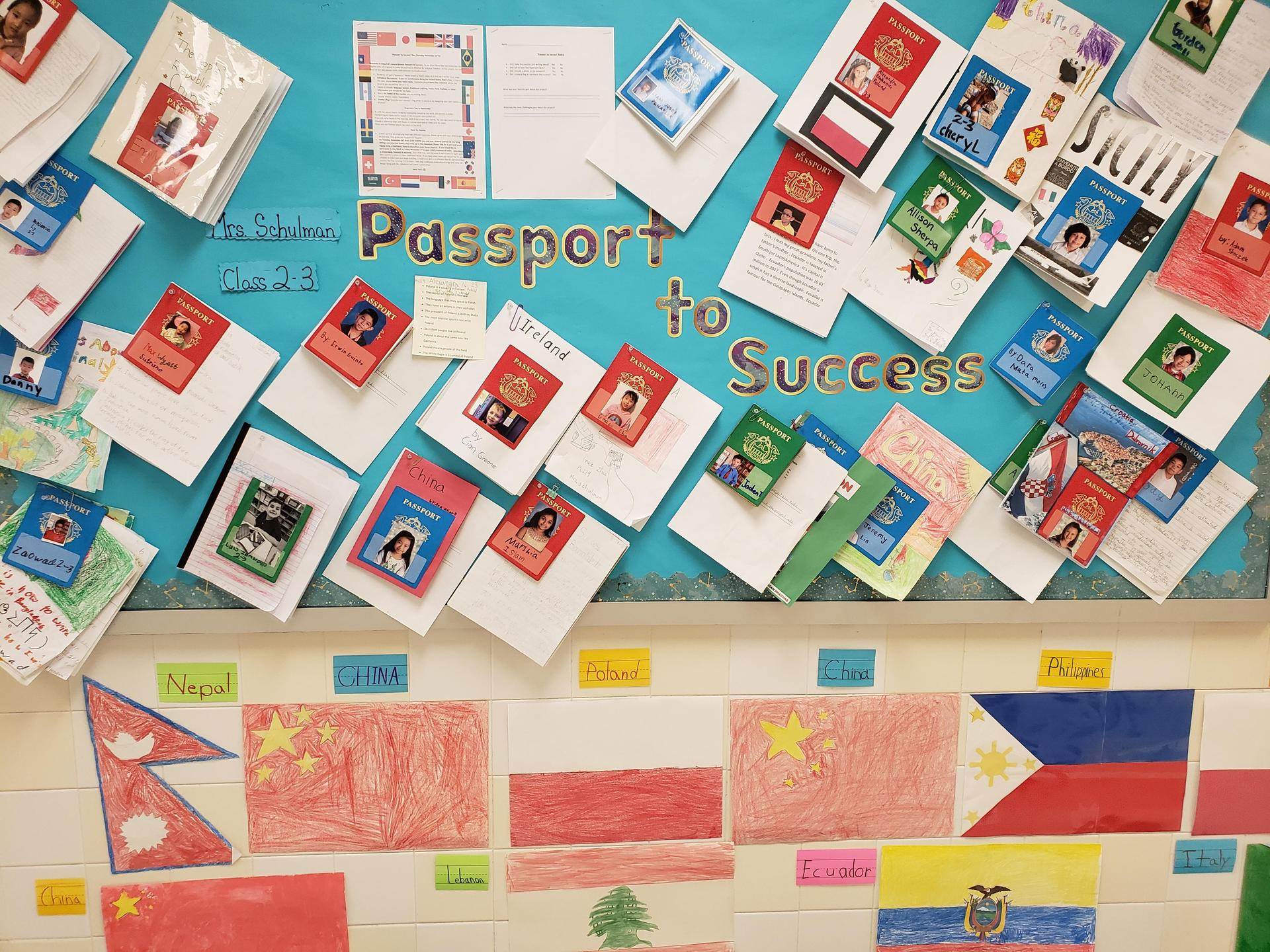 student created passports hanging on bulletin board