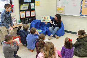 teacher reading to group of students