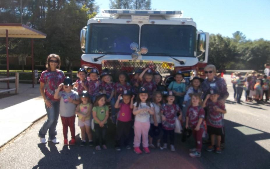 BFES students pose in front of fire engine.
