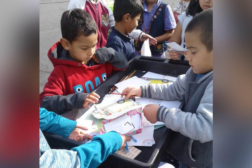 Schweitzer students writing notes of kindness to students and staff during recess
