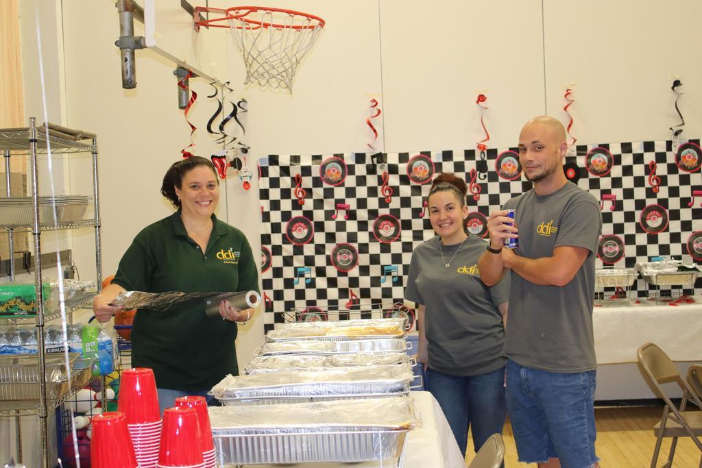 Staff enjoying DSP Week getting lunch ready