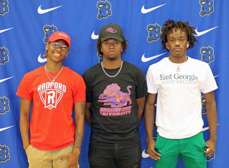 Brunswick High's Makalia Brown, Xavier Bean and Kamori Towns pose for a photo following a signing ceremony held in the school's gymnasium Friday.