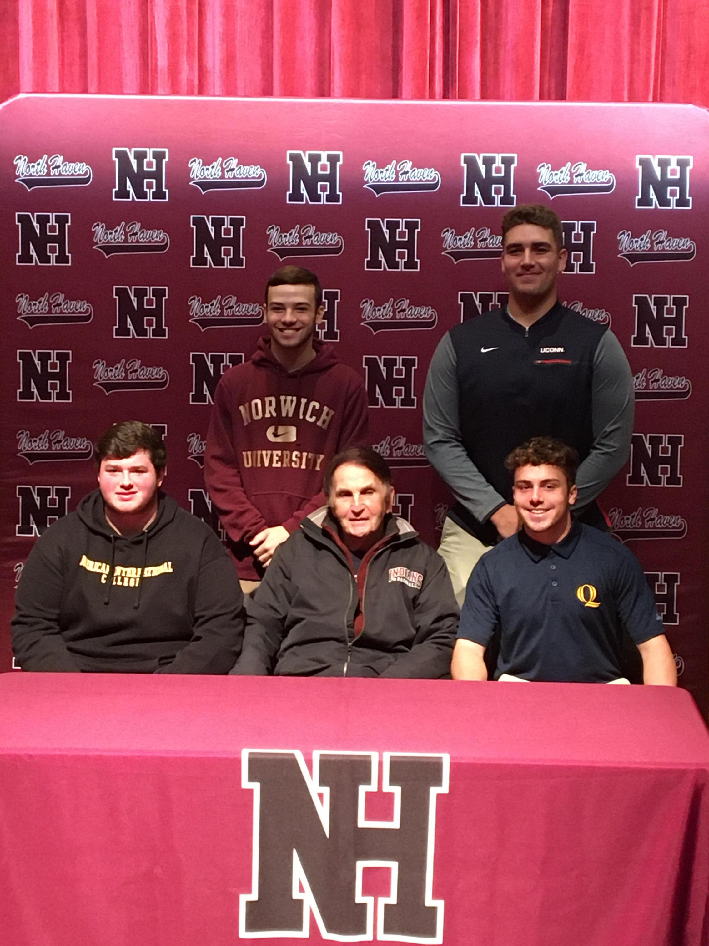 Coach Bob DeMayo and his student-athletes after they signed their NLI.