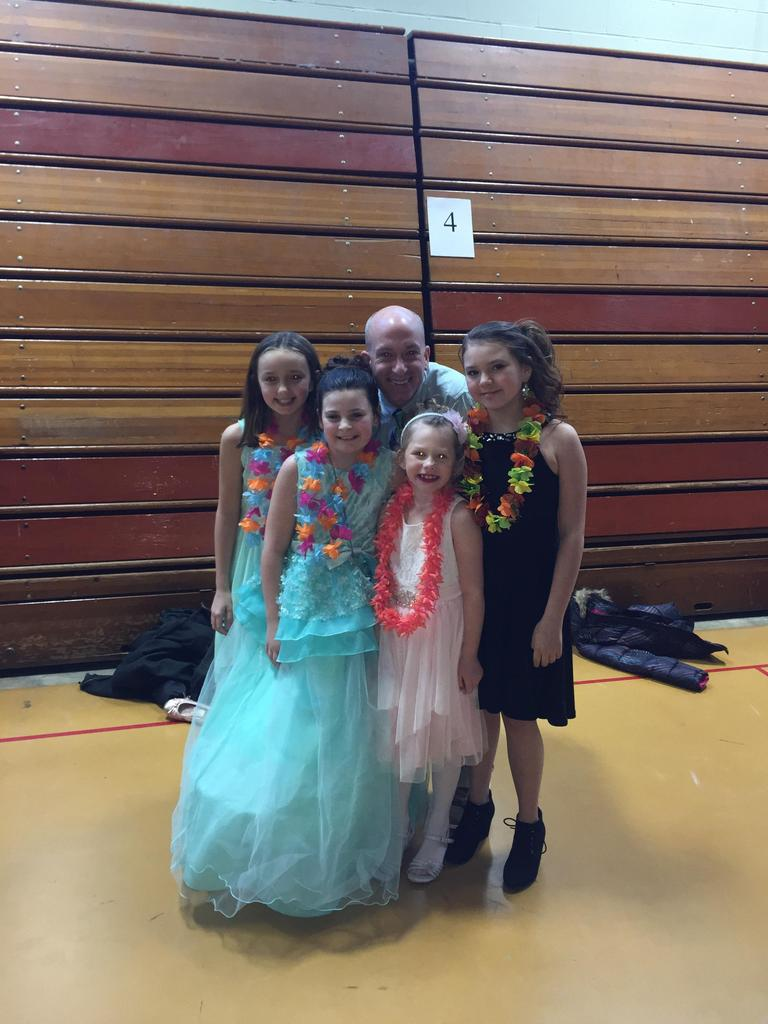 Four female students with a dad at the Daddy-Daughter Dance