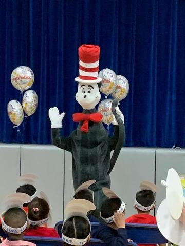 Cat in Hat waving at children
