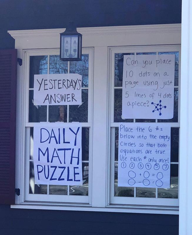 "Westfield High School math teacher Callie Campbell posts a daily math joke and puzzle in the front windows of her Westfield home for passersby.  ""I hope the math joke and puzzle bring a smile or chuckle to people in this time of uncertainty while also serving as a fun learning for people of all ages."""