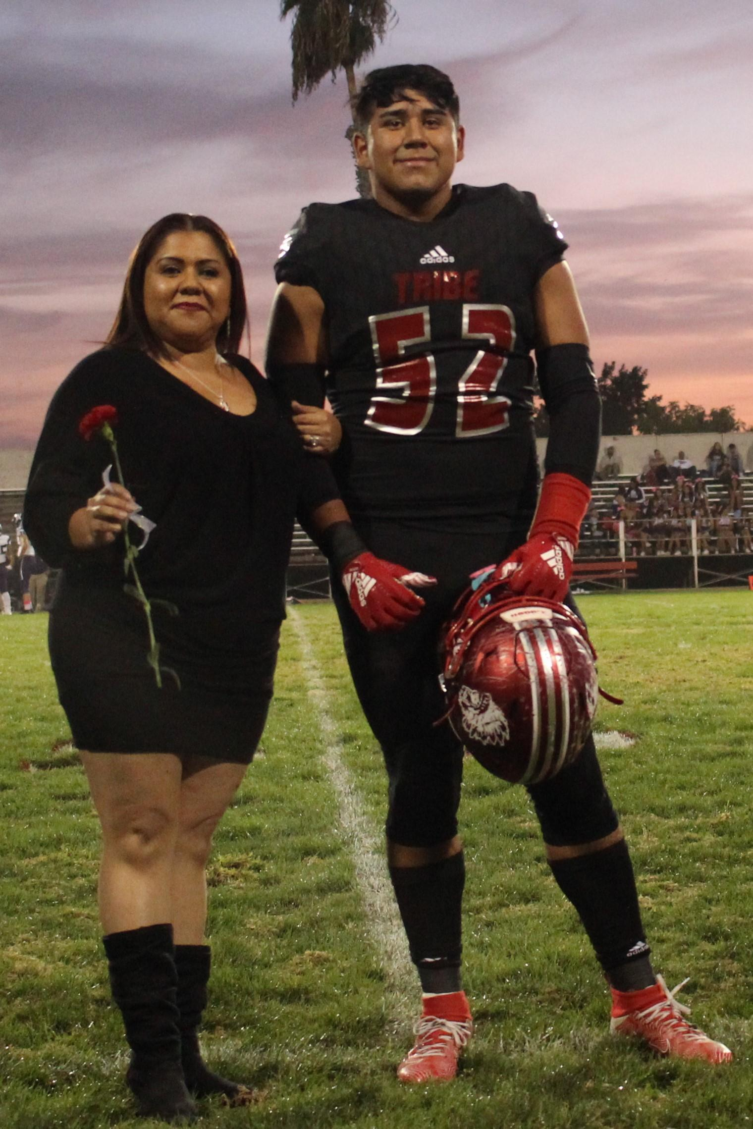 Senior football player Damian Rodriguez and his escort.