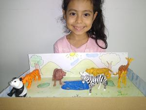 Student smiling with her savanna project