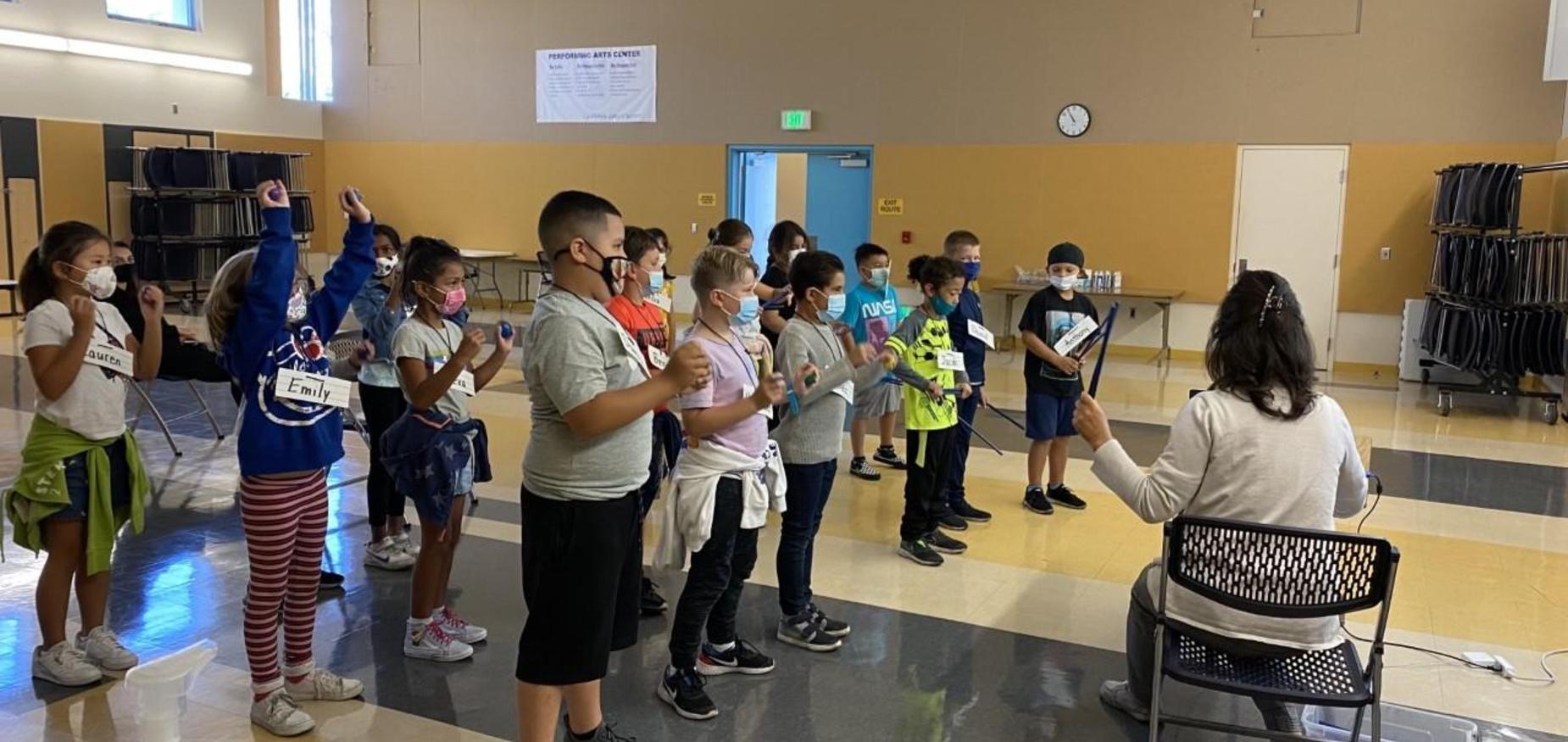 Room 11 playing instruments in music class