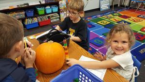 Kindergarten measuring pumpkins