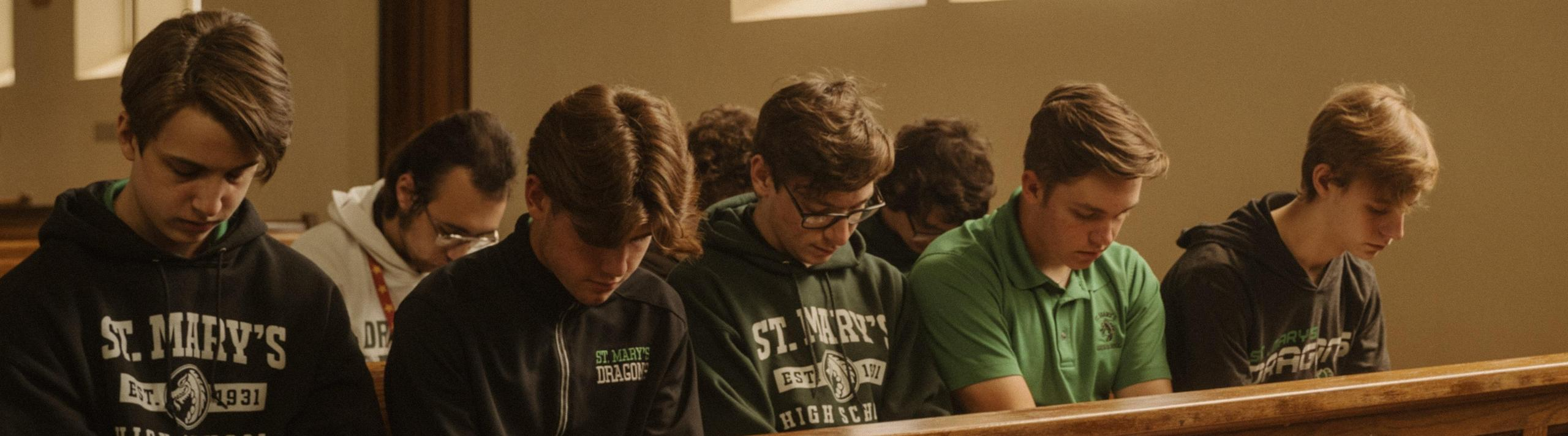 Students pray in the Holy Family Chapel