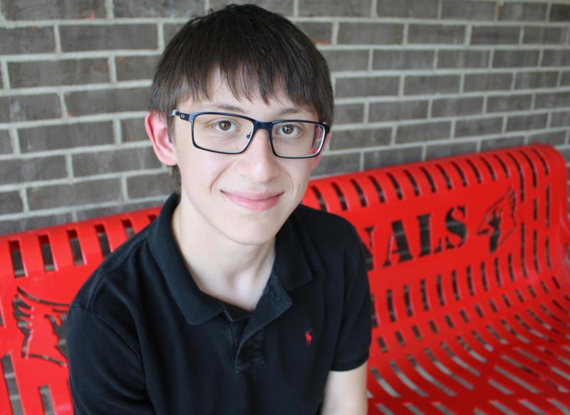 Picture of Riley Sheridan on bench outside Mayfield High School