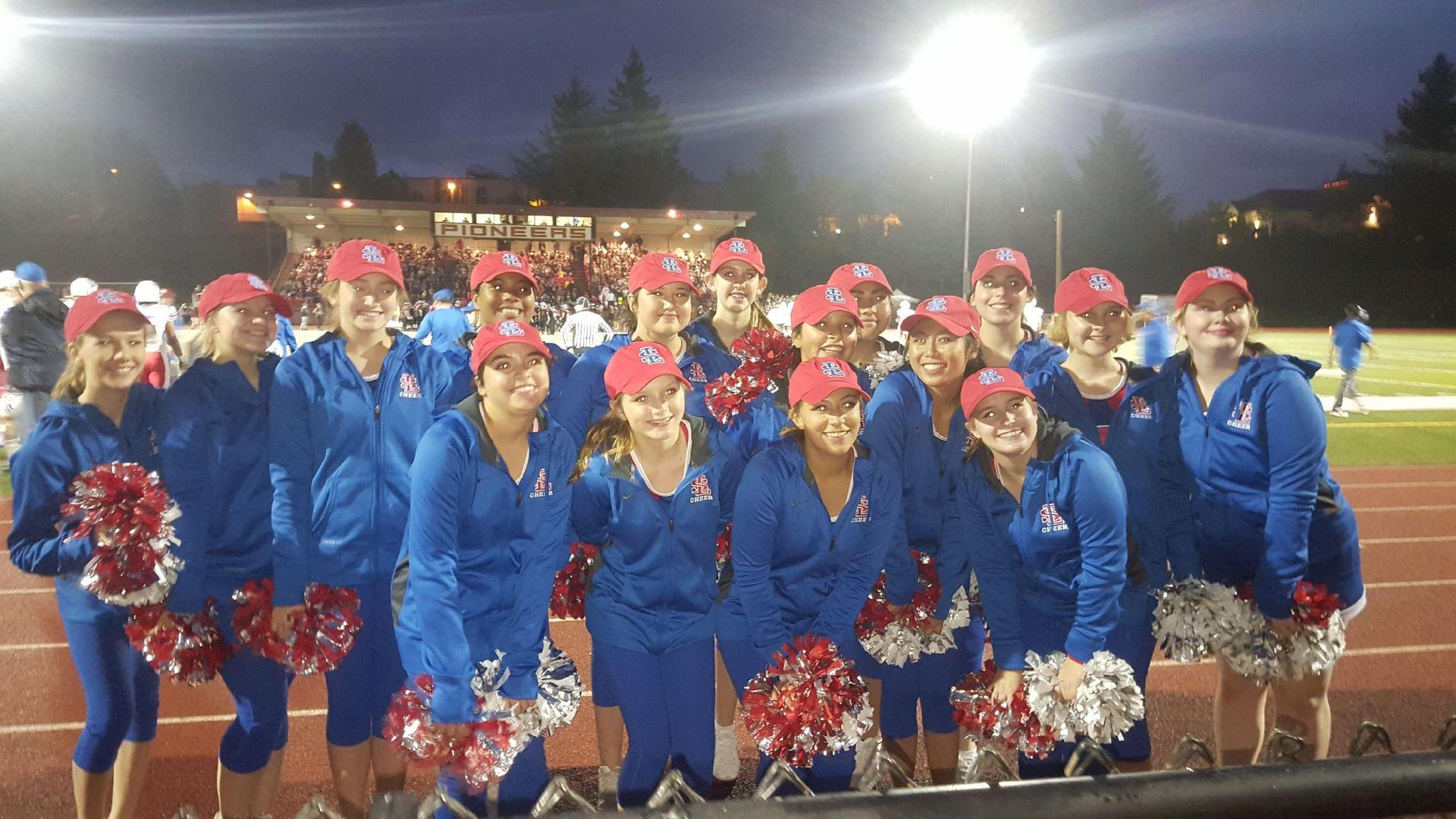 cheer squad at evening football game