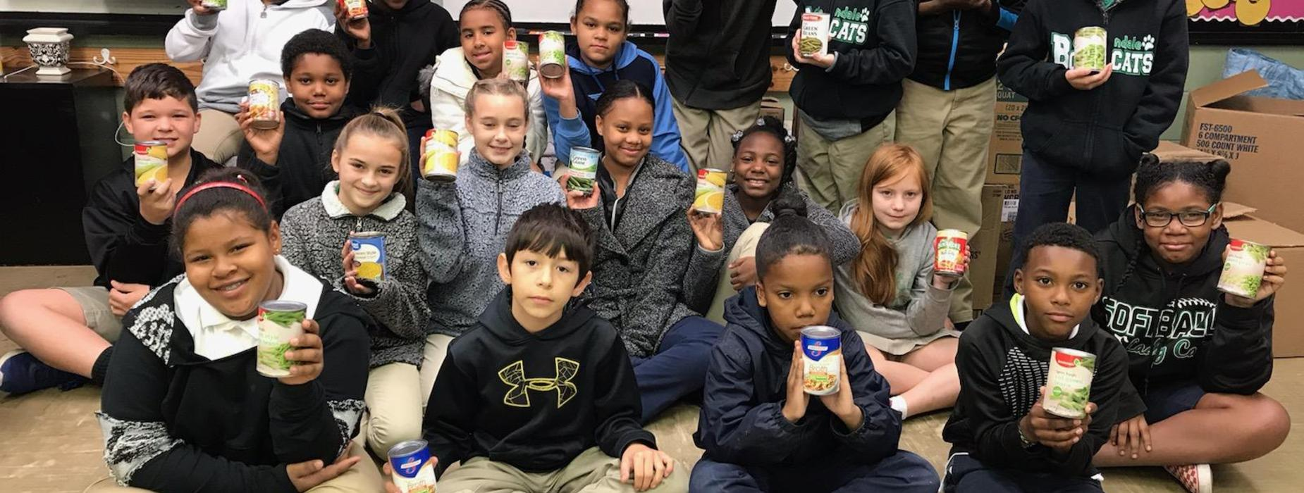 n the Spirit of Giving, Ms. Stelly's class helps collect can goods for the needy families in our community. With the generosity of our Glendale family, we collected over 1,500 can goods. Each year, we work in conjunction with the Eunice Rotary club to help the citizens of Eunice.