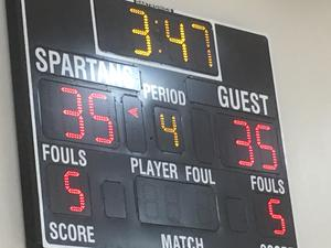 basketball scoreboard with tied scores for home and guest teams