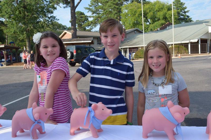 Students Feed the Pig at the Back to School Barbecue