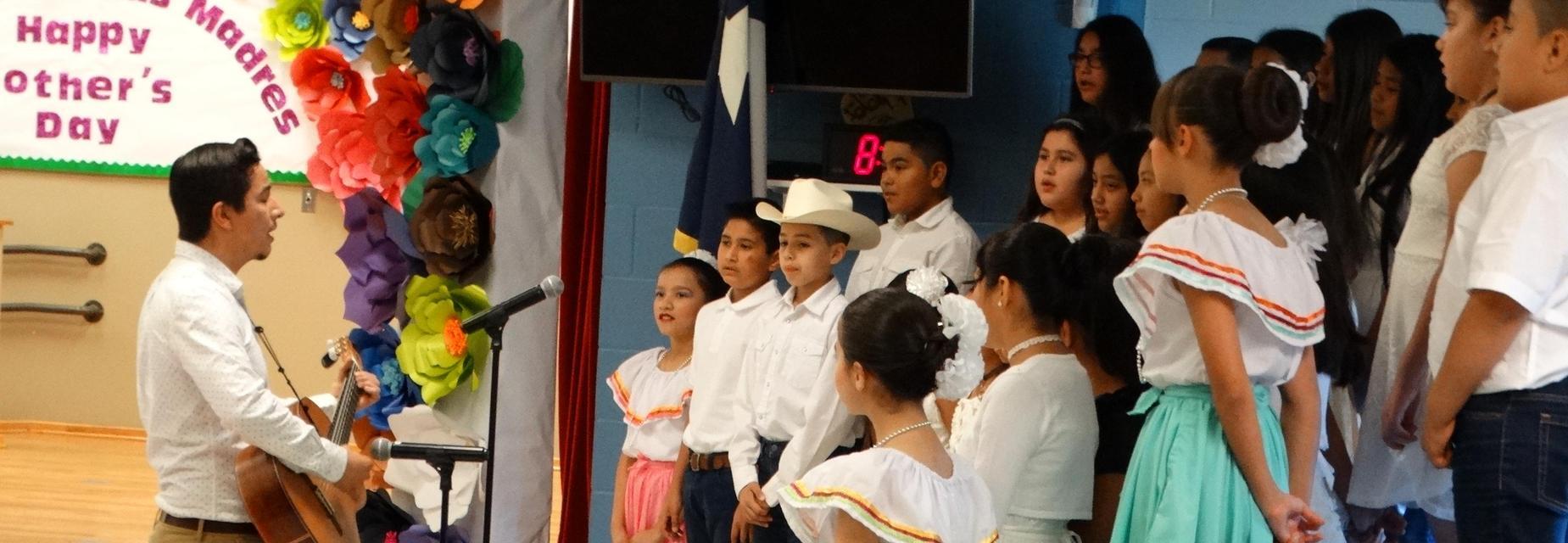 Choir group performing with music teacher