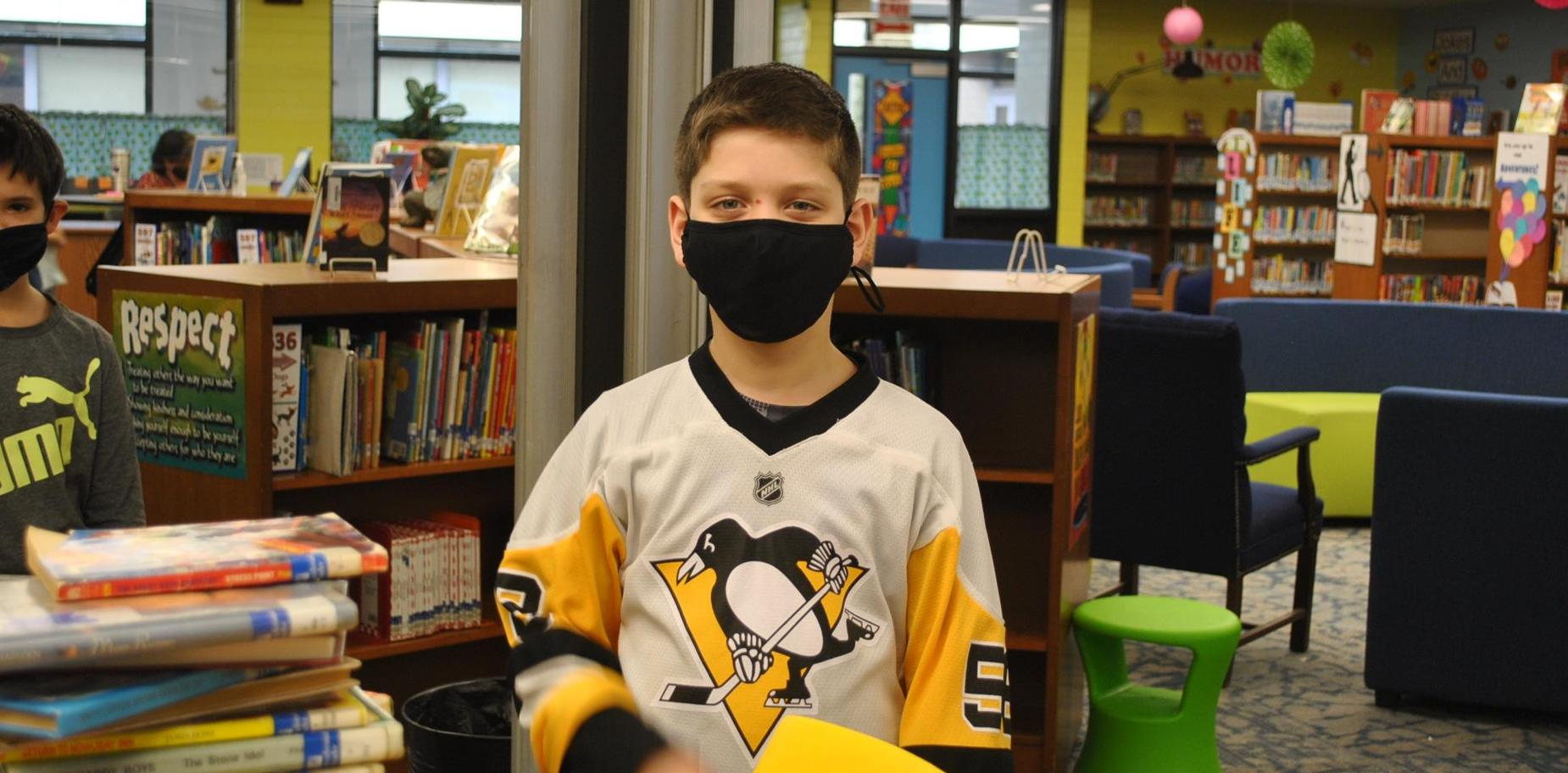 student in Pens jersey