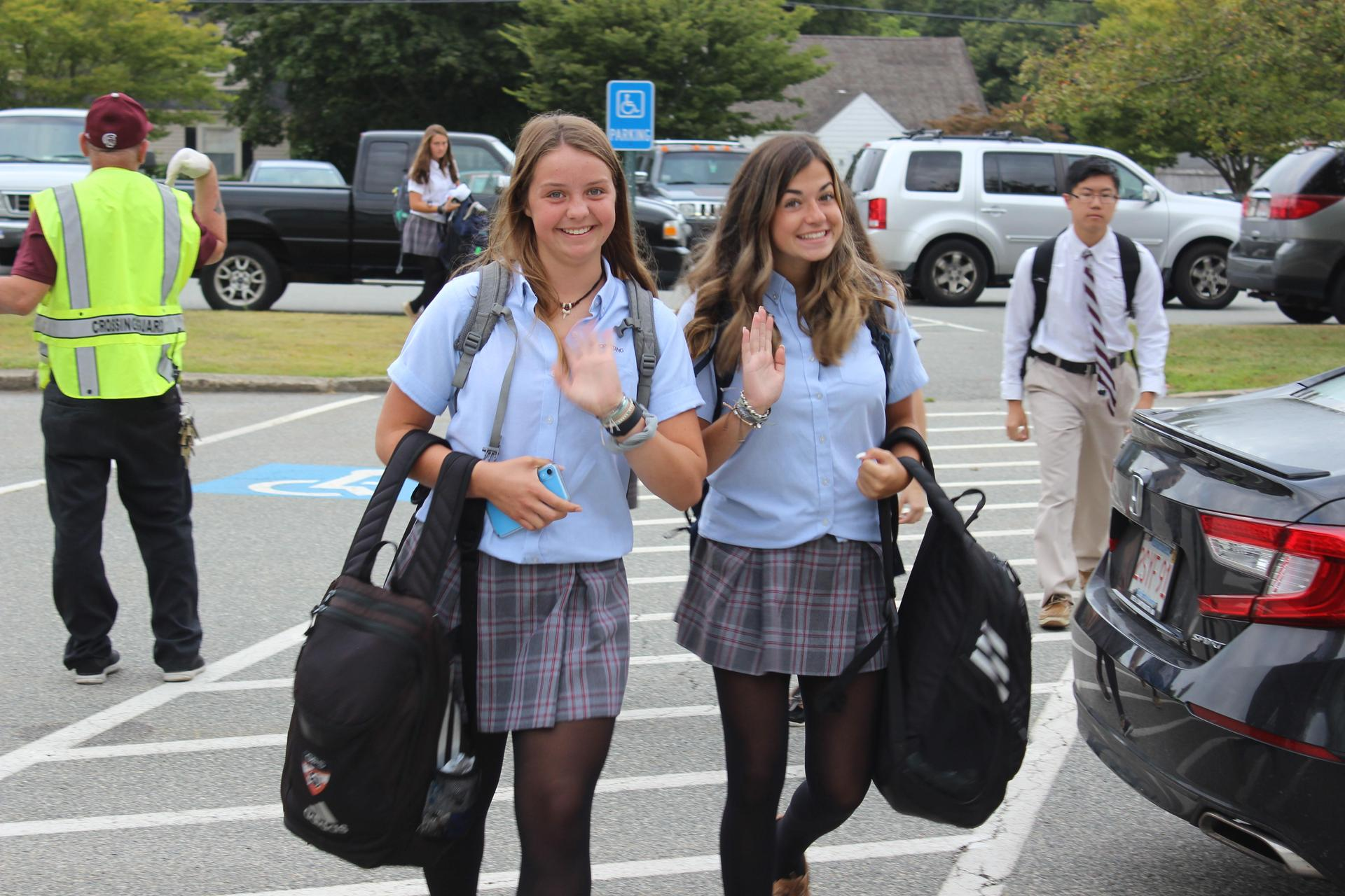 girls arriving at school