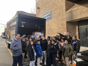 Emerson Students loading up truck with collected foods for the needy