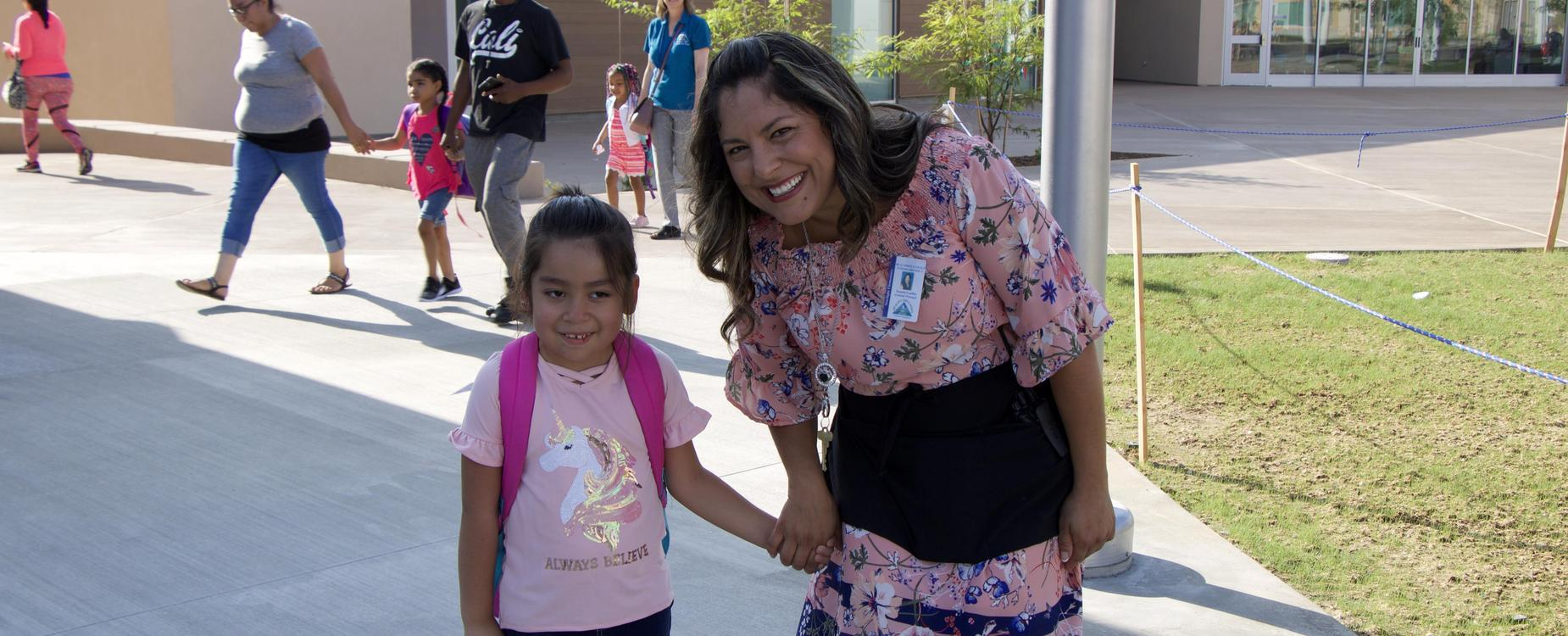 Starlight Elementary Assistant Principal walking student to class
