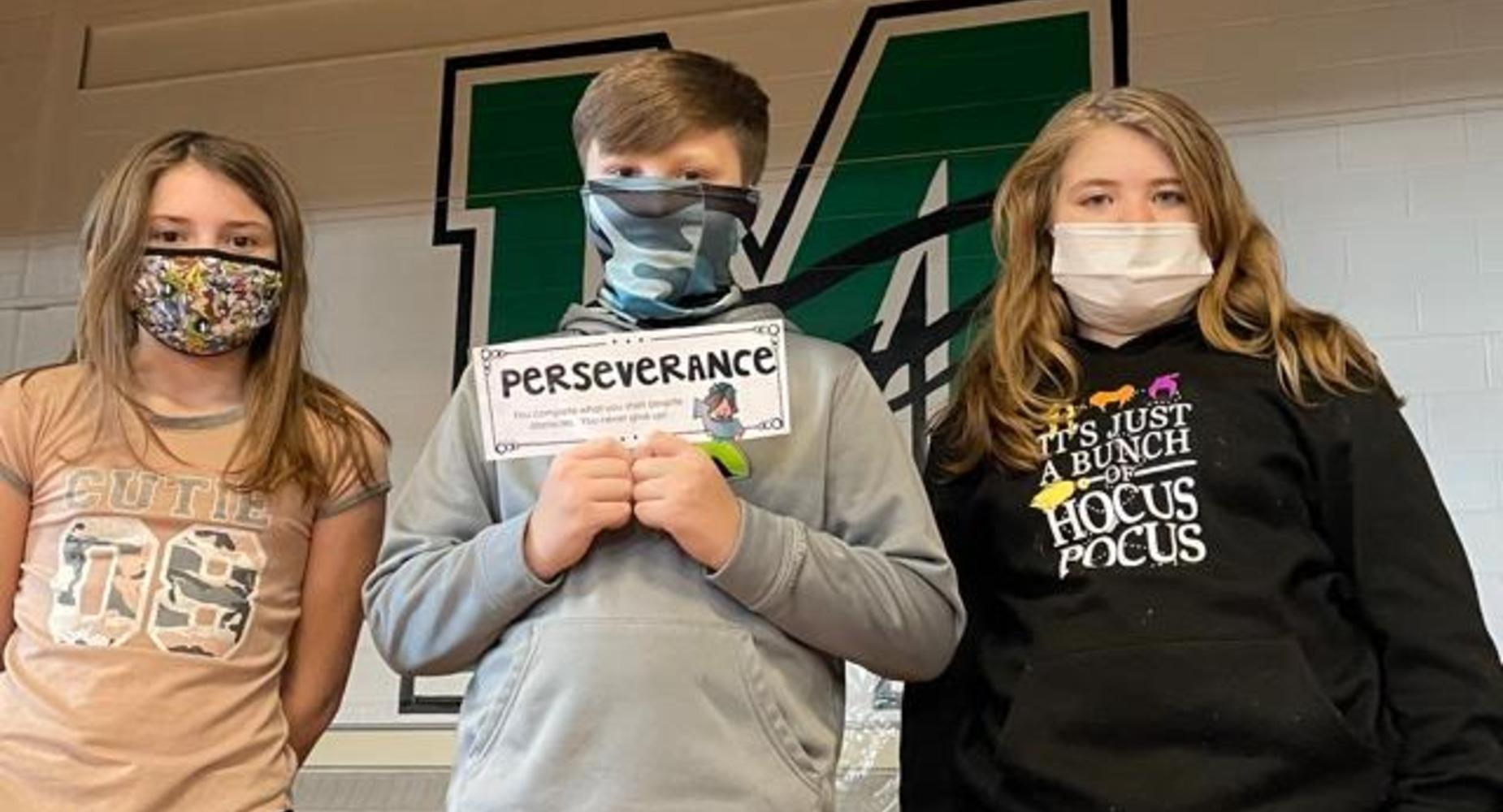 students with perseverance sign