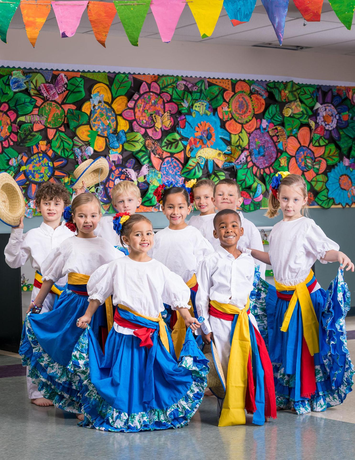 children dressed in colombian outfits