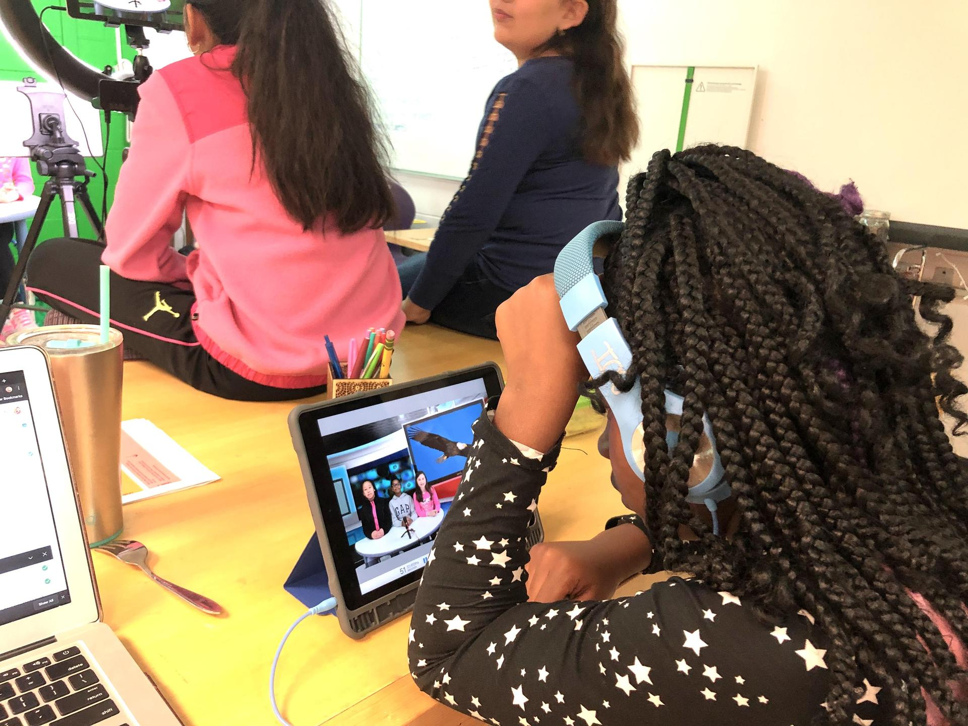 Young girl looking at iPad