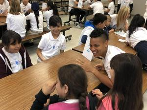 students gather in cafeteria to kick off compassion project