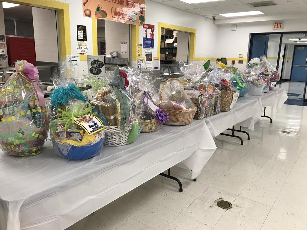 all the themed baskets lined up on display at the head table