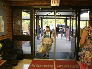 Students enter the building on the first day of school.