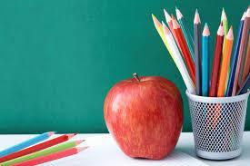 apple and colored pencils