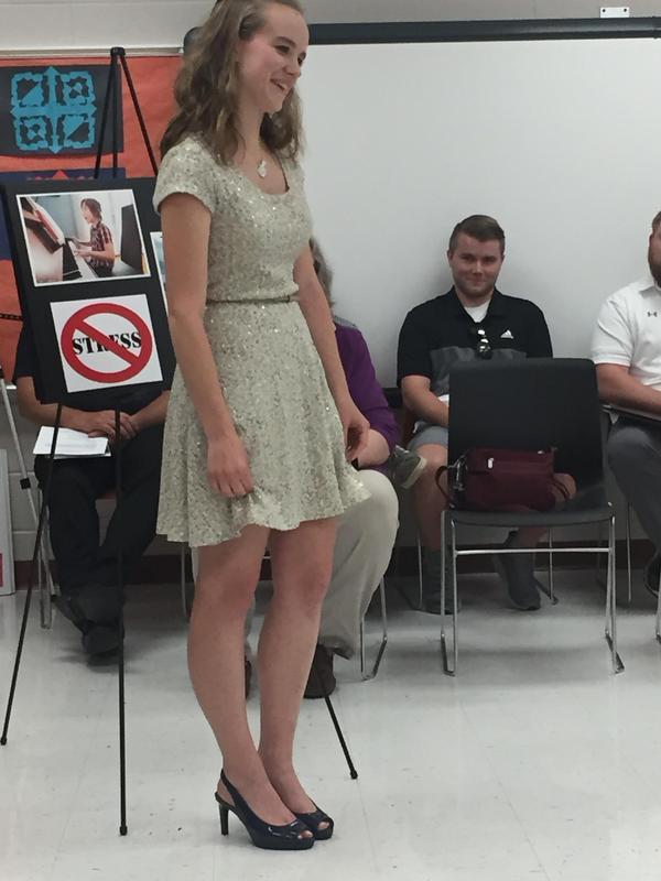 Hannah Tavani presents to the school board.
