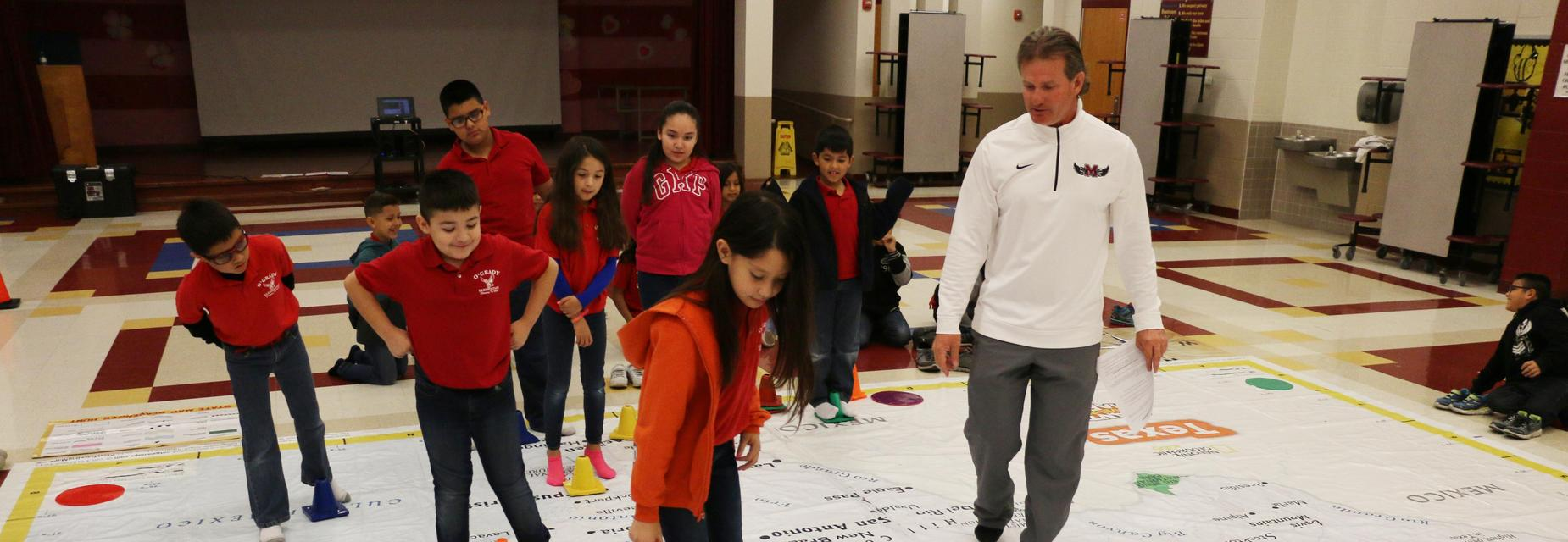 O' Grady Elementary students learn about the big giant traveling map through their Physical Education classes.