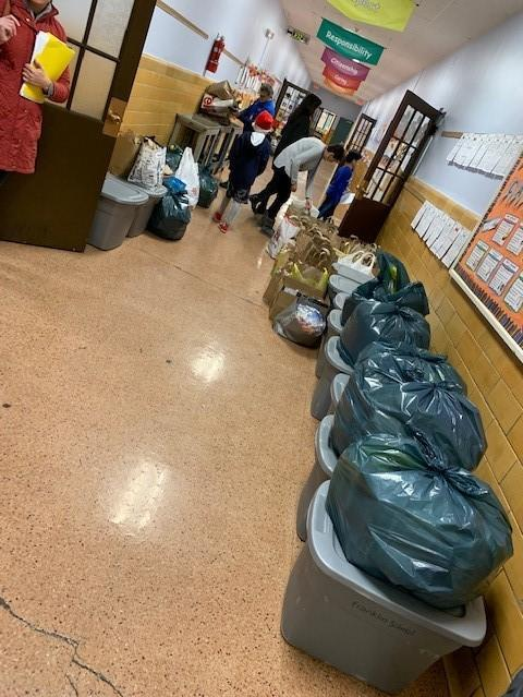"""Westfield students also continued the weekly tradition of bringing and making extra lunches on a designated day to donate to local charities, including St. Joseph's Social Service Center in Elizabeth.  """"We call it """"Two Lunch Tuesday"""" and this week, we increased the donated lunches by promoting a contest among the classes,"""" says Franklin principal Dr. Eileen Cambria on Nov. 20.  """"The grade level with the most lunches was rewarded with an extra recess period.""""  Pictured here are baskets of food items lining the hallways of Franklin School."""