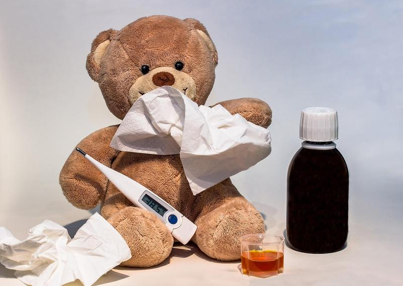 Bear with tissue, thermometer, and cough syrup