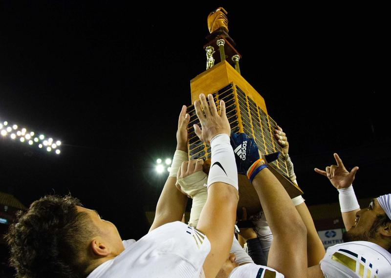 raising trophy