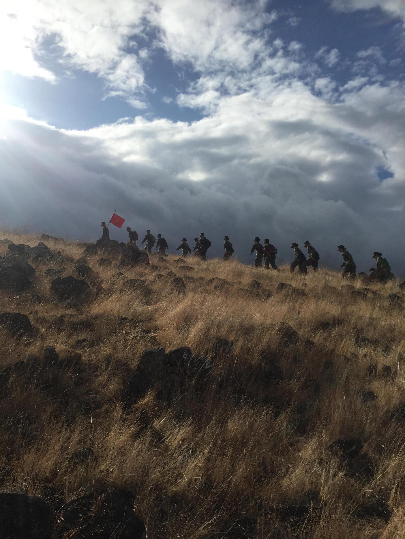 MCJROTC cadets climbing hill