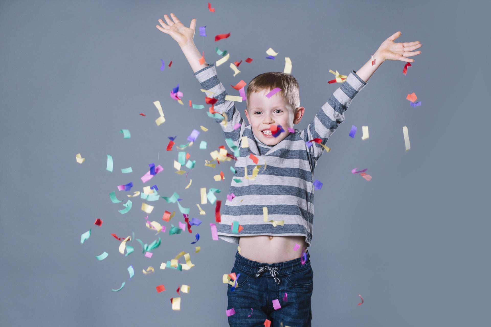 cute boy throwing confetti