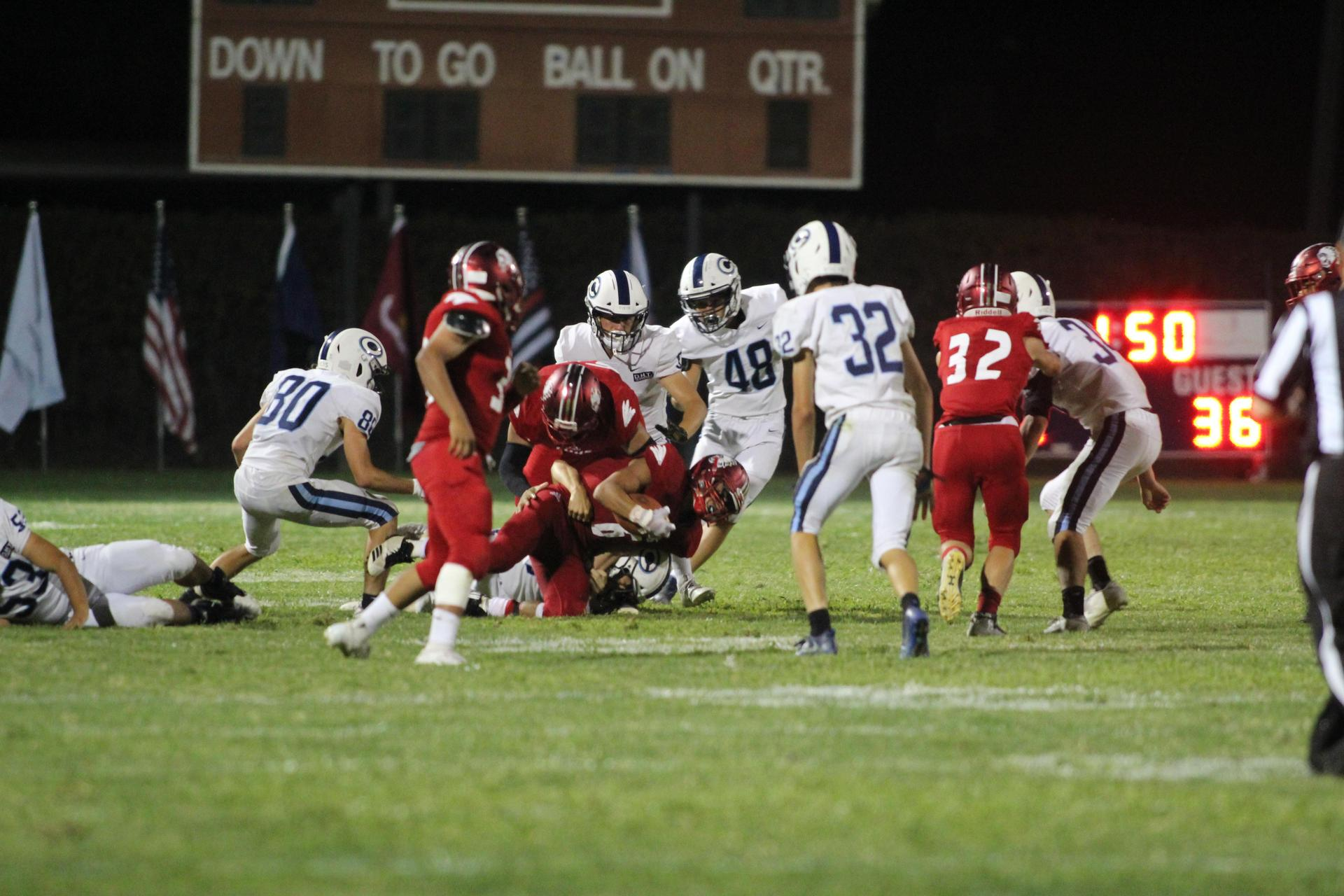 Varsity football in action against Central Valley Christian