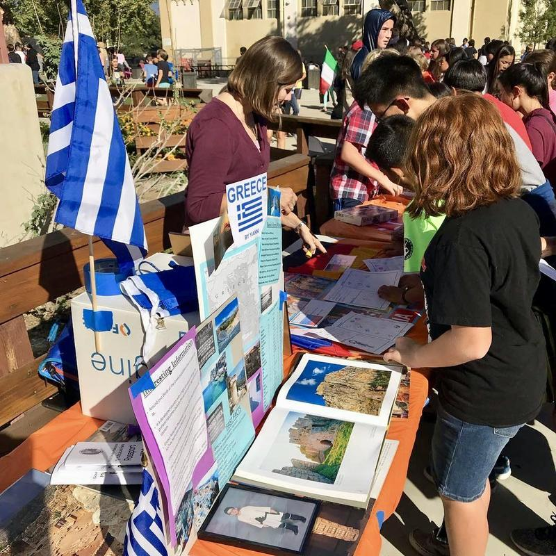 Students look at table at the Multicultural Faire