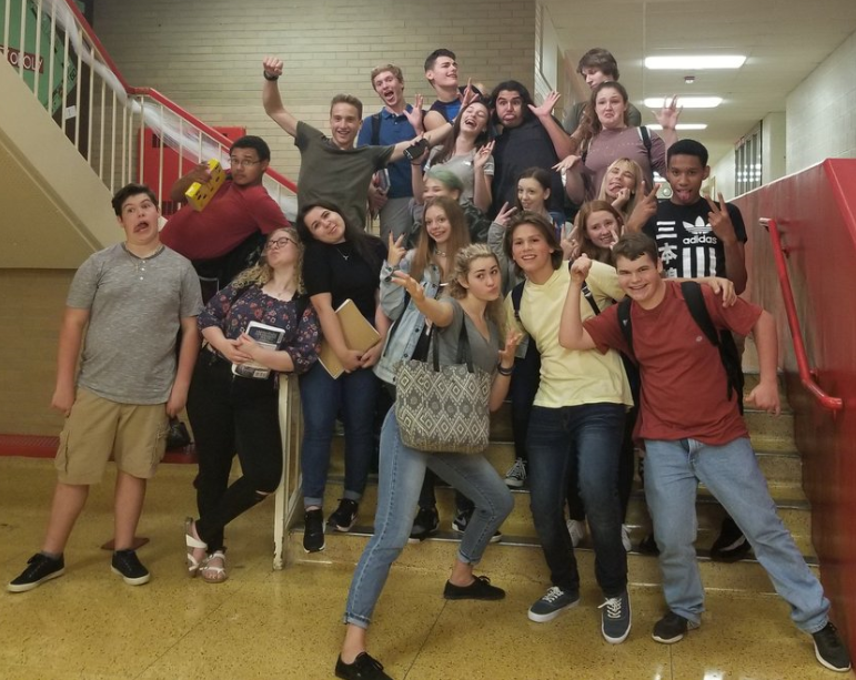 SCHS Drama Club poses for a photo at the school's main staircase adjacent to the Main Office