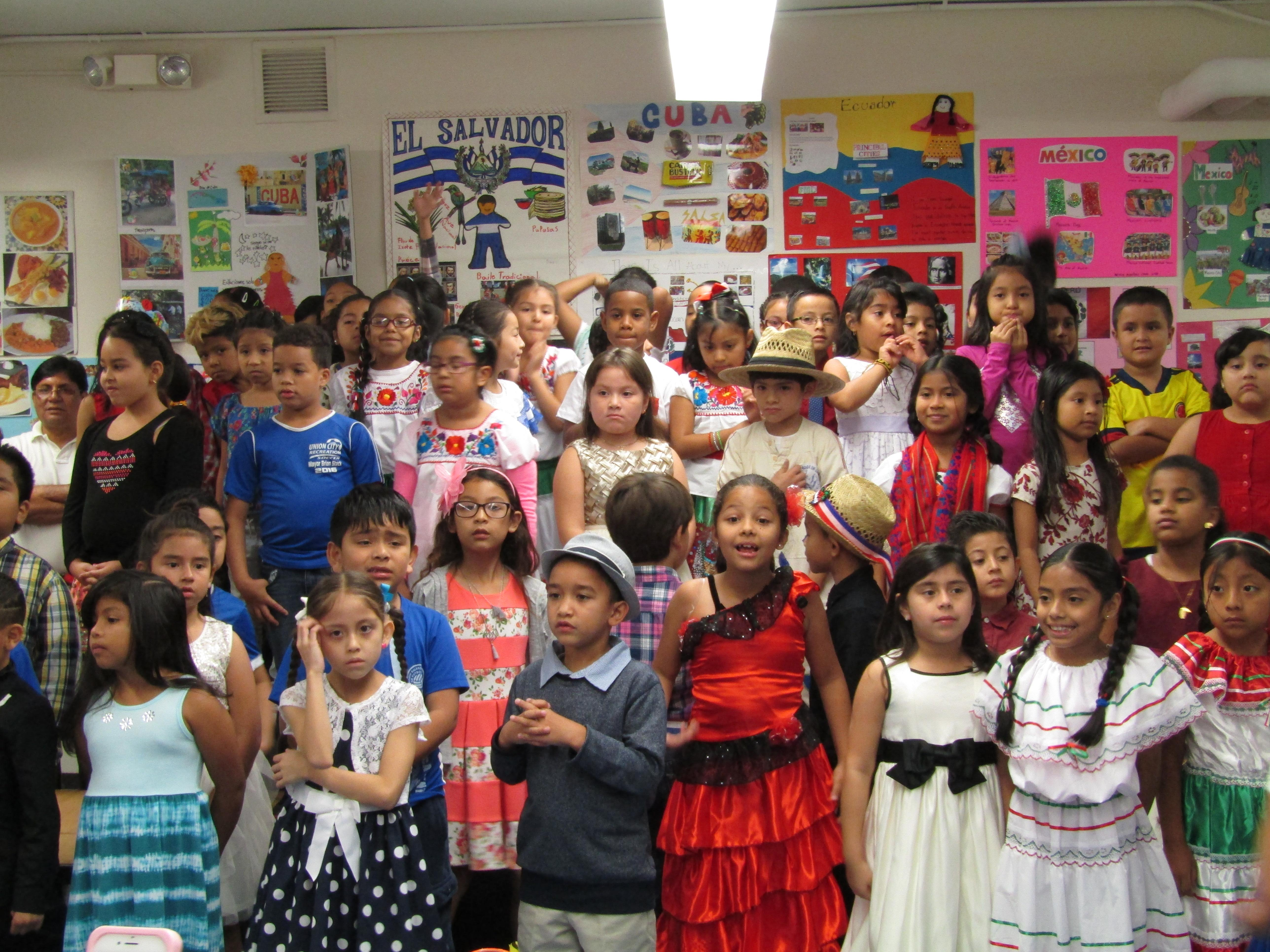 students dressed in national costume to celebrate hispanic heritage
