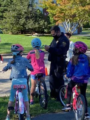 An officer instructs a rider