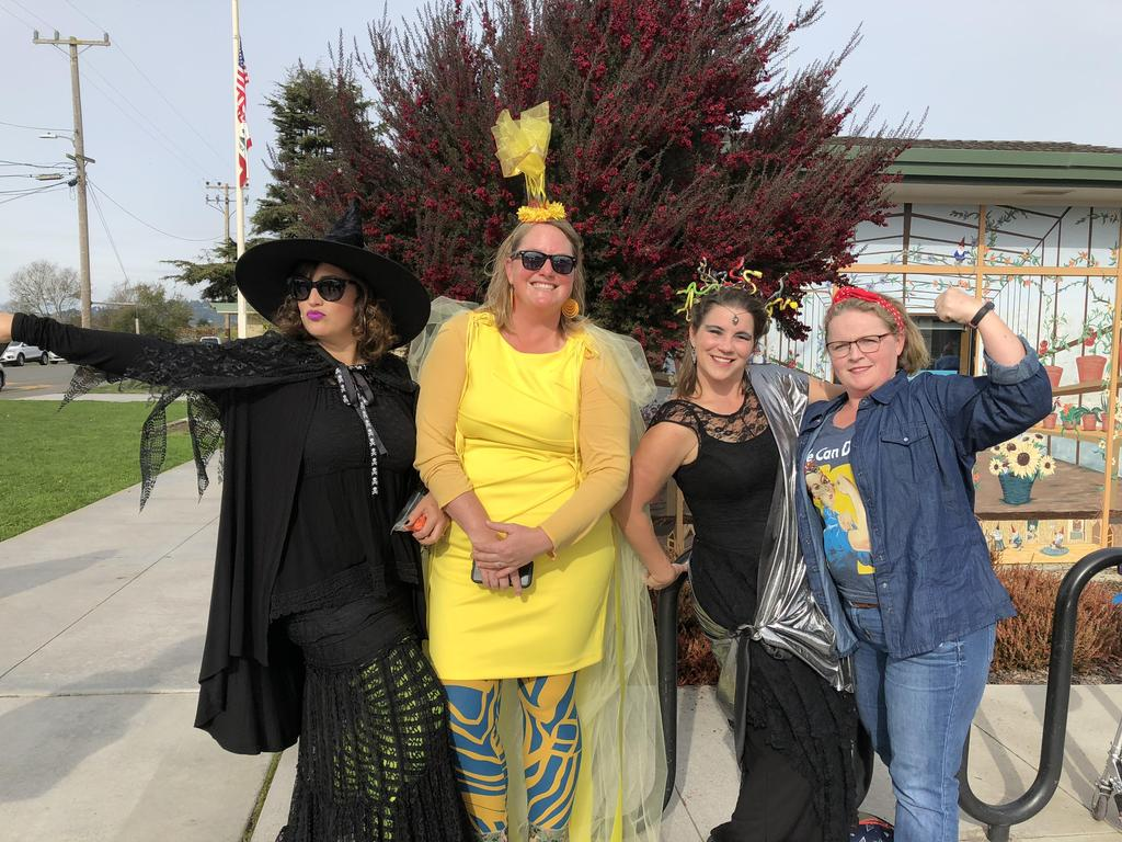 4 parents dressed as a witch, ray of sunshine, Medusa, and Rosie the Riveter